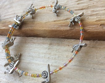 Snail Bracelet on memory wire with multi coloured seed beads