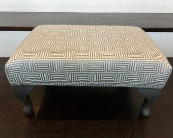 Chic handmade upholstered footstool in Italian fabric with Annie Sloane painted feet