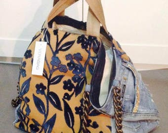 Shopping bag with second-hand jeans and finest fabric