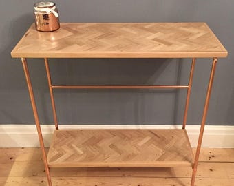 Hallway console table / sideboard in a retro industrial style with a copper pipe frame and reclaimed oak herringbone inlay