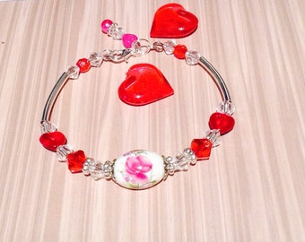 Bracelet with Vintage floral bead, crystals and small heart shaped red beads.