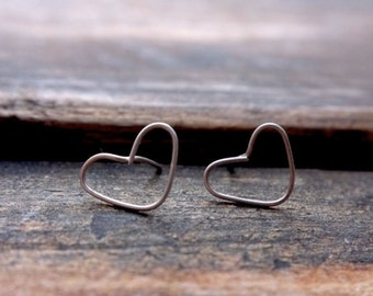 Sterling Silver earring with hurt - About Love