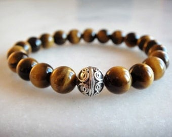 Yellow tigers eye bracelet with sterling silver Bali bead