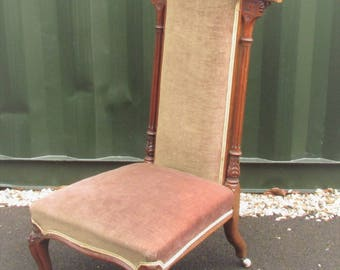 A lovely antique high back chair. Victorian with lots of carved details