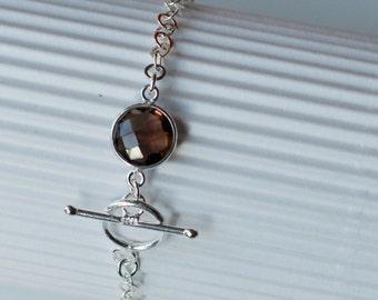 Massive silver bracelet and smoked quartz