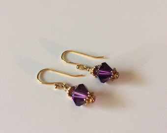 Dainty earrings with amethyst Swarovski crystals and gold vermeil accents.