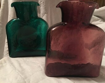 2 water pitchers or vases 1 burgundy 1 green