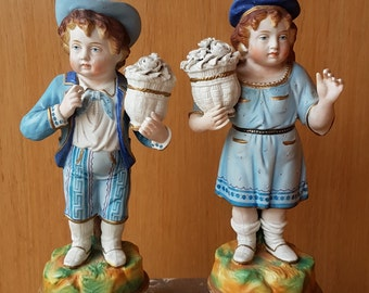 Pair of Bisque porcelain children statues