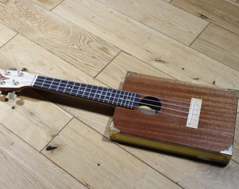 Handcrafted tenor scale Cigar Box Ukulele with solid mahogany sound board.