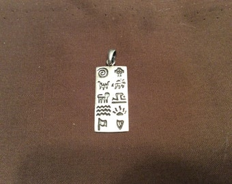 Vintage Sterling Silver Story Teller Pendant Hieroglyphic Symbals