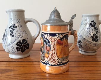 Collection of three German steins/jugs