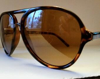 Oversized brown tortoiseshell plastic 80s aviator sunglasses