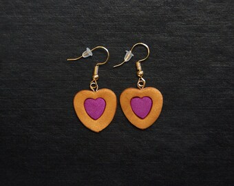 Polymer clay dangle double heart earrings, small inside large.