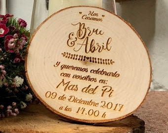 Invitations of wedding in slice of wood