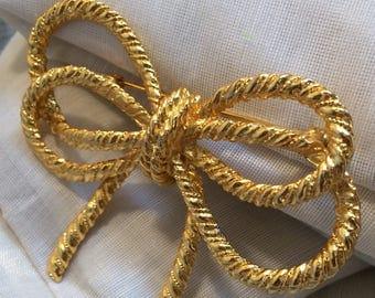Goldtone Ropelike Ribbon Brooch