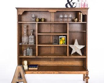 Unique oak bookcase with Art Nouveau style detailing
