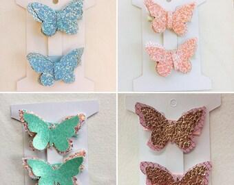 Pink glitter butterfly clips