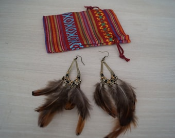Very pretty earrings feather ethnic...