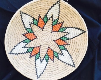 Decorative Woven Basket with Orange, White and Flower in Center