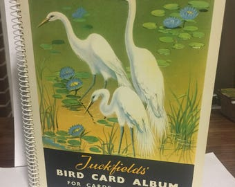Tuckfields c1960's bird card album # 1-96 includes 50 cards lightly stuck down in Album. All in really nice condition.