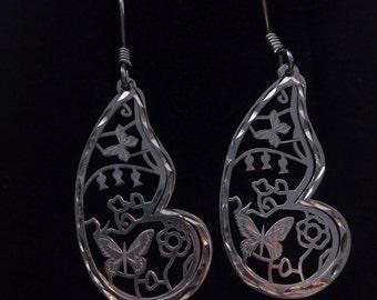 Earrings of silver, earrings of silver, flowers and butterflies.