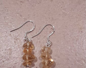 Silver drop earrings with citrine stones.