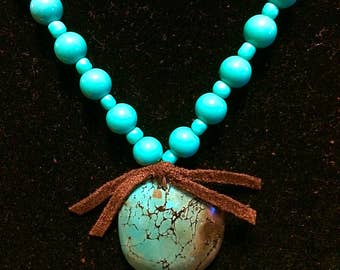 Turquoise beads with turquoise & brown focal drop.