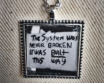 The System Was Never Broken; protest necklace