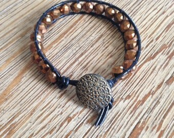 Metallic copper, leather wrap, beaded bracelet
