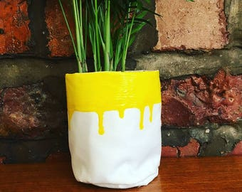 Small yellow paint drip plant sack