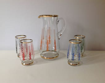 Vintage glass jug and four tumblers from 1970s.