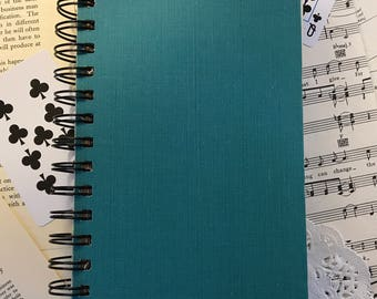 Spiral-bound recycled journal