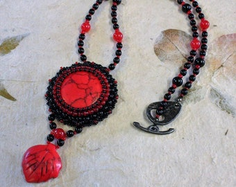 Red and black beaded pendant necklace.