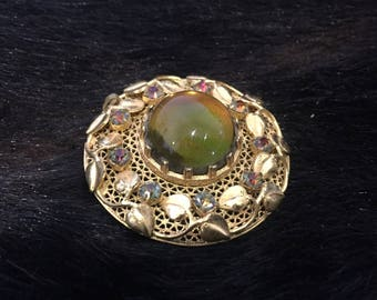 Stunning Detailed Vintage Brooch Leaf Pattern with Aurora Borealis Rhinestones and Large Centre Feature Green Opalesque Glass Bead