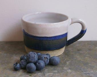 Blue and white striped mug