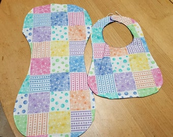 Pastel print bib and burp cloth