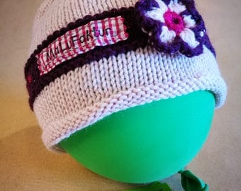 The hand-knitted baby hats / Beanies