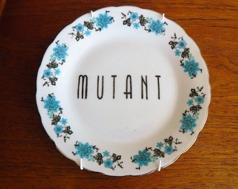 Mutant hand painted vintage porcelain bread and butter plate with hanger recycled humor mutated decor display