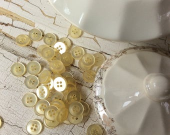 Light yellow shirt button, shiny vintage yellow buttons, set of 45,pale yellow, super shiny, 7/16 inches in dimeter,vintage seventies,NOS