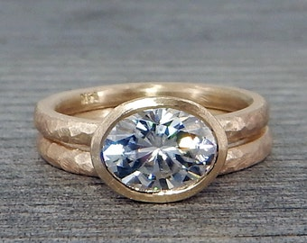 Oval Moissanite Engagement Ring and Wedding Band - Forever One, in Recycled 14k Yellow Gold, Matte, Hammered, Peekaboo Bezel, Made to Order