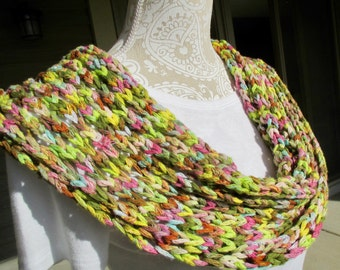 A hand knit cowl, infinity scarf, cowl scarf, single loop scarf, spring summer cowl, lightweight cowl, fashion cowl in multi pastel colors.
