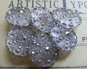 "Six Silver On Clear Glass Buttons. Vintage. Measure just under 3/4""."