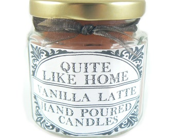 Vanilla Latte scented 4 oz. jar candle with gold lid, and organza ribbon. Coffee shop, lattes, vanilla extract, homey, sweet,  robust