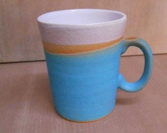 Stoneware turquoise dip mug.
