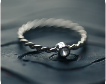 White Sapphire and Sterling Silver Twisted Ring