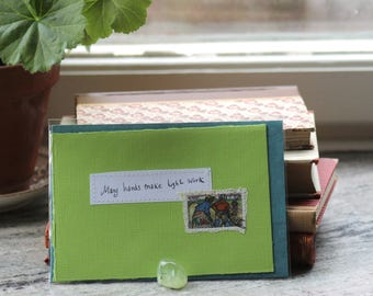 Many hands make light work Apple green card with handwritten quote and Zambian postal stamp