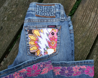 Steal Your Face Grateful Dead pocket OOAK jeans UltraLove size 7 bell bottoms flares patch flower trim hem