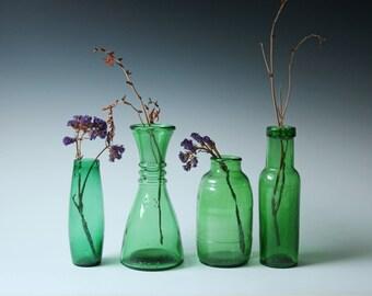 Collection of 4 antique vintage emerald green bottles - flower vase
