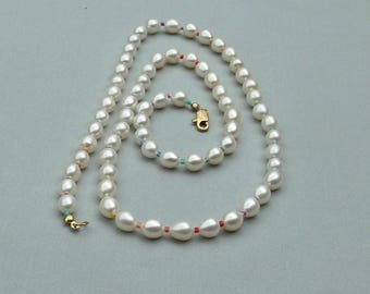 Cultured freshwater pearl LGBTQ necklace hand knotted on silk 24 3/4 inches