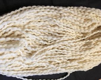 Handspun yarn, super soft puffy, light ply 135 yds natural color, knits up beautifully